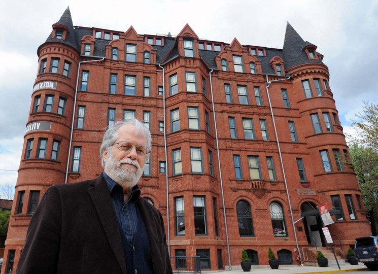"Allen C. Abend, author of ""Baltimore's Forgotten Women,"" is pictured outside Hotel Brexton. His book is about 19th century artists who lived in Mount Vernon. Three of them lived in the Brexton. (Kim Hairston/The Baltimore Sun)"
