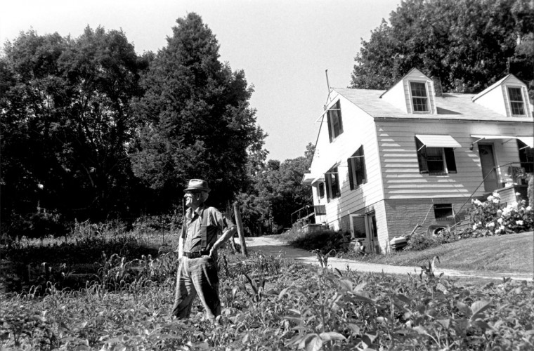 Paul Corun, former owner of Paul's Market on Main Street in Ellicott City, MD., he sold rabbits, chickens, racoons, muskrats and other animals -- live and fresh killed. Here he works in the garden on his Ellicott City property. Mandatory Credit Photo by Peggy Fox. (Photo scanned 03/19/2001) Handout Photo