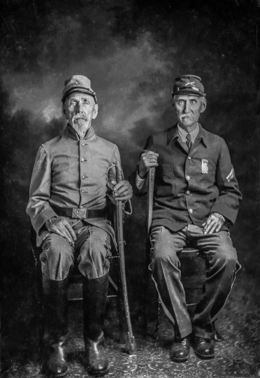 The circumstances are not completely known, but Finley Taylor somehow managed to get these veterans of opposing forces in the Civil War to pose for a photograph in his studio in Richwood, W. Va. The date is unknown.