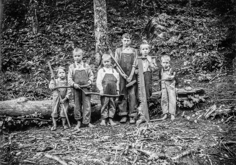 "Children of the forest with their fathers' tools, and one revolver. According to ""Last Photographers,"" four of these boys were members of the Mullens family of Richwood."