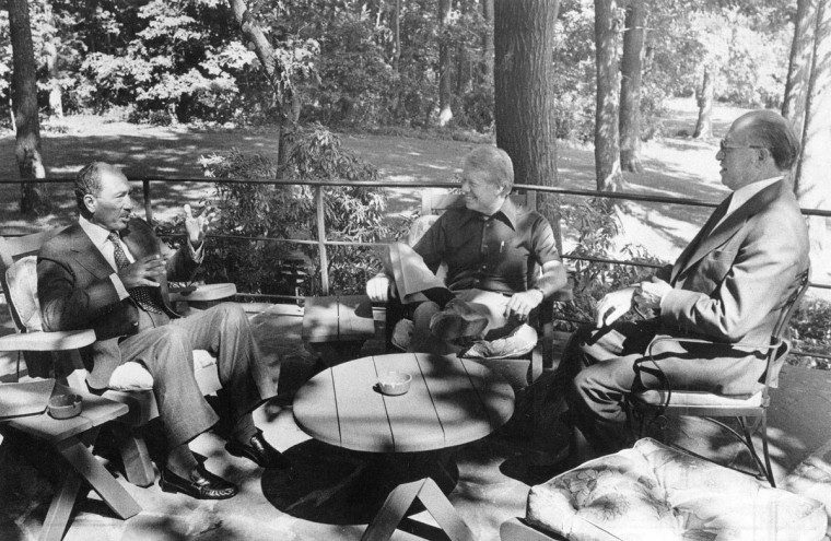 This Sept, 6, 1978 photo provided by the White House shows the principals in the Middle East Summit, from left, Egyptian President Anwar El Sadat, President Jimmy Carter, and Israeli Prime Minister Menachem Begin, meeting for the first time at Camp David, Md. (White House via AP)