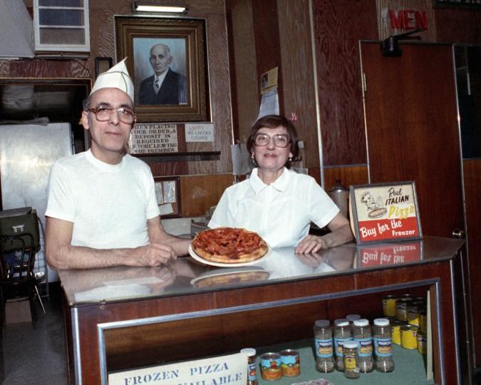 Feb 05, 1985 Photo by Ellis Malashuk/The Baltimore Sun Staff - File Photo. Feature of Mathew's Pizzaria in Highlandtown. Frank Ciociolo and Jenny Perticone w/ portrait of Matthew Ciociolo in background.