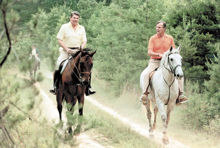 Undated photo of George Bush and Ronald Reagan horseback riding at Camp David. (Baltimore Sun archives)