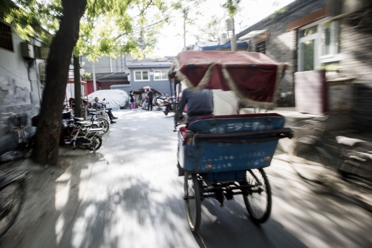 This photo taken on April 22, 2017 shows a rickshaw driver riding in Beijing. Appearing in China at the end of the 19th century, rickshaws originally had two wheels and were pulled by their driver on foot, with passengers seated at the back. Today, most of the vehicles are tricycles - some still have pedals and are propelled by physical force, but the majority are equipped with electric or gas engines. (FRED DUFOUR/AFP/Getty Images)