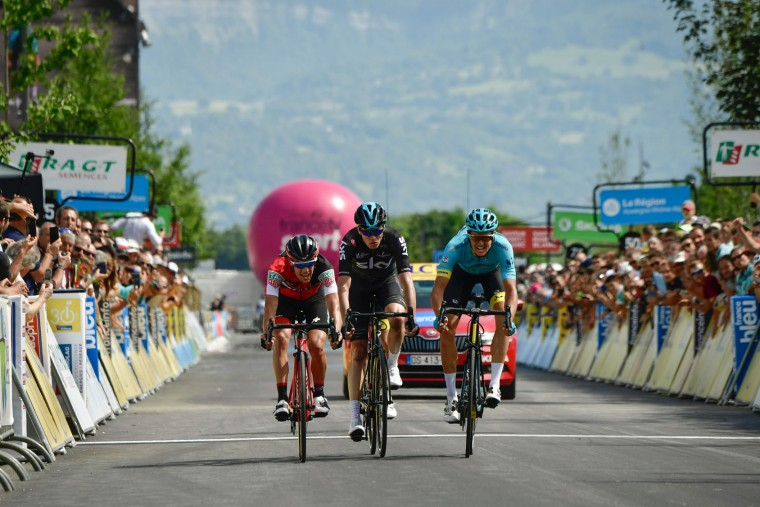 Denmark's Jakob Diemer Fuglsang (R) celebrates after crossing the finish line ahead of Australia's Richie Porte (L) and Great Britain's Christopher Froome (C) at the end of the 147,5 km sixth stage of the 69th edition of the Criterium du Dauphine cycling race on June 9, 2017 between Villars-les-Dombes and La Motte-Servolex. (Philippe Lopze/AFP/Getty Images)