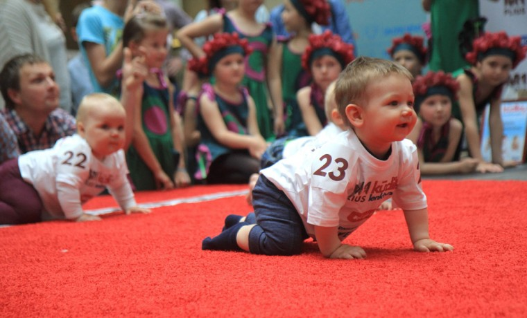 Babies take part in a Baby Race to mark international Children Day in Vilnius, Lithuania on June 1, 2017. Ten-month-old Mykolas Pociunas crawled to victory to be crowned Lithuania's fastest toddler, lured across the finish line by a box of Lego plastic bricks. Parents and grandparents waved colourful toys, mobile, phones, balloons, TV remote controls, plastic bottles and even bagels to get their tots across the finish line. (PETRAS MALUKAS/AFP/Getty Images)