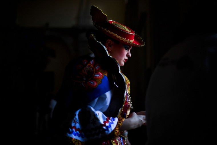A girl from the typical Lisbon neighborhood, Alfama, leaves her home prior to attending the Santo Antonio de Lisboa's Parade on Avenida da Liberdade, in Lisbon on June 12, 2017. Lisbon celebrates Saint Anthony's day, the city's protector saint, with a parade that gathers participants from several typical neighborhoods of the city. (Patricia de Melo Moreira/AFP/Getty Images)