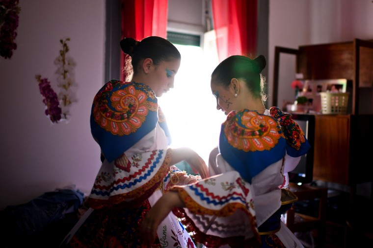 Two girls from the typical Lisbon neighborhood, Alfama, prepare the last details before attending the Santo Antonio de Lisboa's Parade on Avenida da Liberdade, in Lisbon on June 12, 2017. Lisbon celebrates Saint Anthony's day, the city's protector saint, with a parade that gathers participants from several typical neighborhoods of the city. (Patricia de Melo Moreira/AFP/Getty Images)