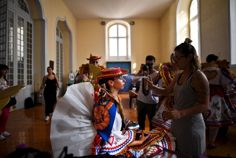 A girl from the typical Lisbon neighborhood of Alfama, dressed up in traditional costumes, is made up before attending the Santo Antonio de Lisboa's Parade on Avenida da Liberdade, in Lisbon on June 12, 2017. Lisbon celebrates Saint Anthony's day, the city's protector saint, with a parade that gathers participants from several typical neighborhoods of the city. (Patricia de Melo Moreira/AFP/Getty Images)