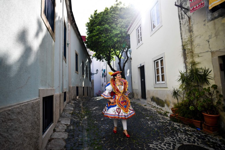 A girl dressed up in traditional costumes walks a street of the typical Lisbon neighborhood of Alfama, before attending the Santo Antonio de Lisboa's Parade on Avenida da Liberdade, in Lisbon on June 12, 2017. Lisbon celebrates Saint Anthony's day, the city's protector saint, with a parade that gathers participants from several typical neighborhoods of the city. (Patricia de Melo Moreira/AFP/Getty Images)