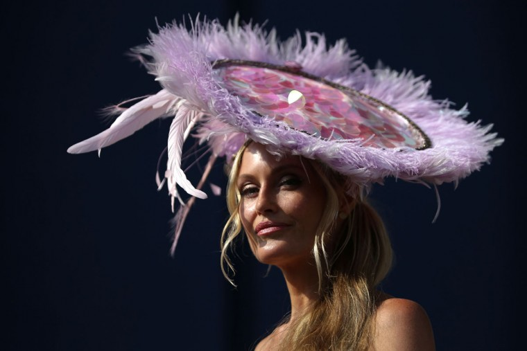 Courtney Murray poses for a picture on day one of the Royal Ascot horse racing meet, in Ascot, west of London, on June 20, 2017.The five-day meeting is one of the highlights of the horse racing calendar. Horse racing has been held at the famous Berkshire course since 1711 and tradition is a hallmark of the meeting. Top hats and tails remain compulsory in parts of the course while a daily procession of horse-drawn carriages brings the Queen to the course. / (AFP Photo/Daniel Leal-olivas)