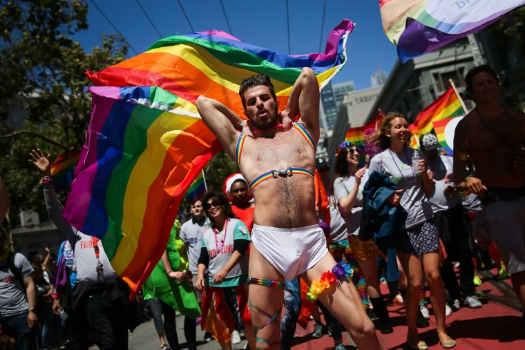 A man dances in the annual LGBTQI Pride Parade on Sunday, June 25, 2017 in San Francisco, California. The LGBT community descended on Market Street for the 47th annual Pride Parade. (Photo by Elijah Nouvelage/Getty Images)
