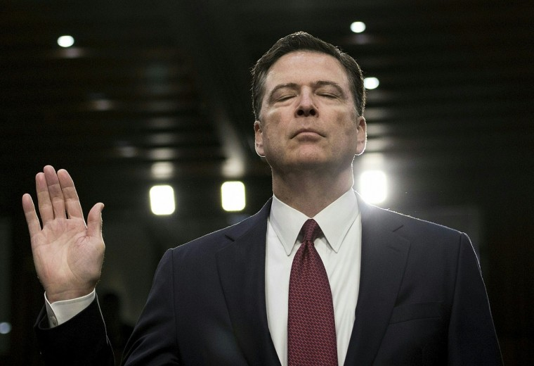 Former FBI director James Comey is sworn in during a hearing before the Senate Select Committee on Intelligence on Capitol Hill June 8, 2017 in Washington, DC.Comey took the stand Thursday in a crucial Senate hearing, repeating explosive allegations that President Donald Trump badgered him over the highly sensitive investigation Russia's meddling in the 2016 election. / (AFP Photo/Brendan Smialowski)