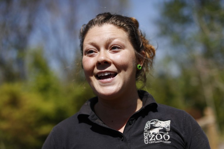 "In this Wednesday, April 12, 2017, photo, Zookepper Jenna Wingate speaks during an interview about Fiona, the Cincinnati Zoo & Botanical Gardens' new baby hippo, at the Hippo Cove exhibit, in Cincinnati. After months of backlash over the zoo's fatal shooting of Harambe, a gorilla who became a pop culture phenomenon in death, baby Fiona is the new center of attention there. ""She has brought everyone together,"" said Wingate, one of Fiona's caregivers. ""It brings us to tears sometimes."" (AP Photo/John Minchillo)"