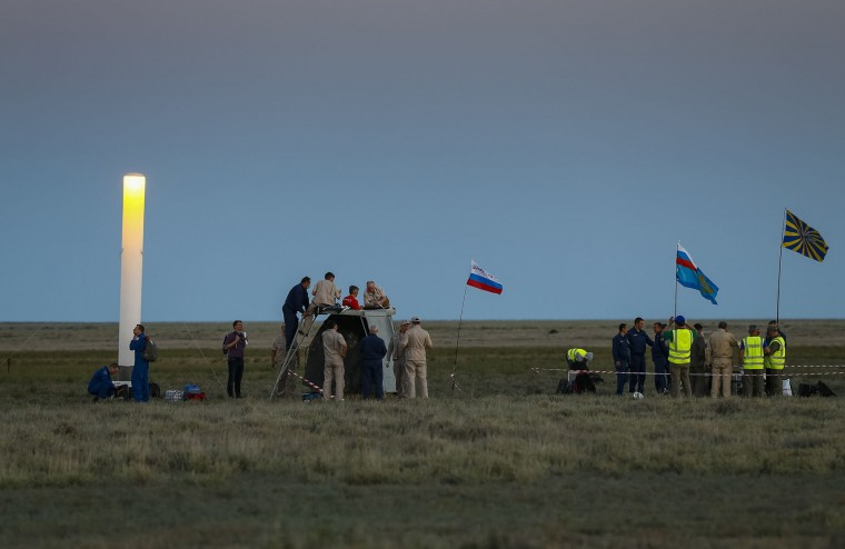 Search and rescue team works on the site of landing of the Russian Soyuz capsule with two astronauts after a half-year aboard the International Space Station, in a remote area outside the town of Dzhezkazgan, Kazakhstan, Friday, June 2, 2017. The capsule with the International Space Station (ISS) crew of Russian cosmonaut Oleg Novitsky and French astronaut Thomas Pesquet, landed Friday on the steppes of Kazakhstan. (Shamil Zhumatov/Pool Photo via AP)