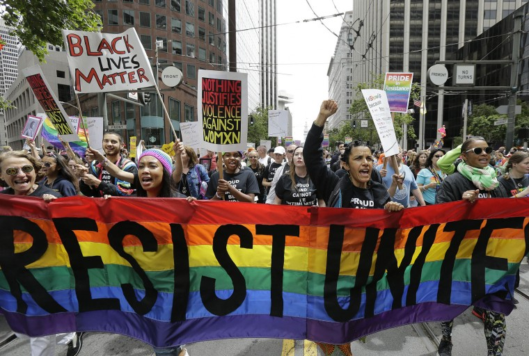 A group of marchers yell during the Pride parade in San Francisco, Sunday, June 25, 2017. (AP Photo/Jeff Chiu)
