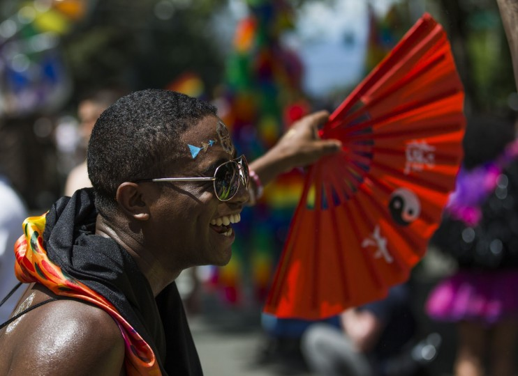 A parade participant fans the crowd during the Seattle Pride Parade on Sunday, June 25, 2017, in Seattle. (Kjell Redal/The Seattle Times via AP)