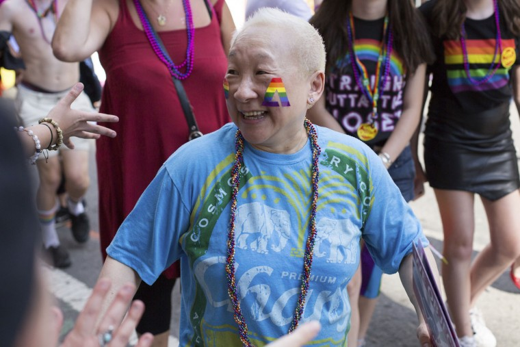 Lori Tan Chinn greets fans in the crowd during the New York City Pride Parade, Sunday, June 25, 2017, in New York. (AP Photo/Steve Luciano)