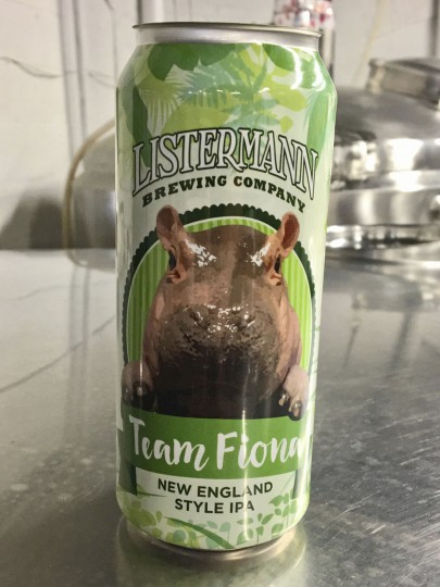 This May 15, 2017, photo provided by the Cincinnati Zoo & Botanical Garden shows a can for Listermann Brewing Company's Team Fiona beer, featuring an image of the Nile hippopotamus named Fiona born prematurely Jan. 24 at the zoo in Cincinnati. Zoo officials say the Cincinnati microbrewery's New England-style India pale ale will be introduced June 10 with 25 percent of proceeds from sales at seven Cincinnati-area stores earmarked for the zoo's #TeamFiona fundraising campaign. (Chad Yelton/Cincinnati Zoo & Botanical Garden via AP)