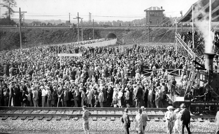 October 2, 1927-THE FAIR OF THE IRON HORSE--WHILE THE CROWDS MILL AROUND--Part of the throng leaving the Grandstand after the Pageant of Transportation at the Fair of the Iron Horse. (Baltimore Sun archives)