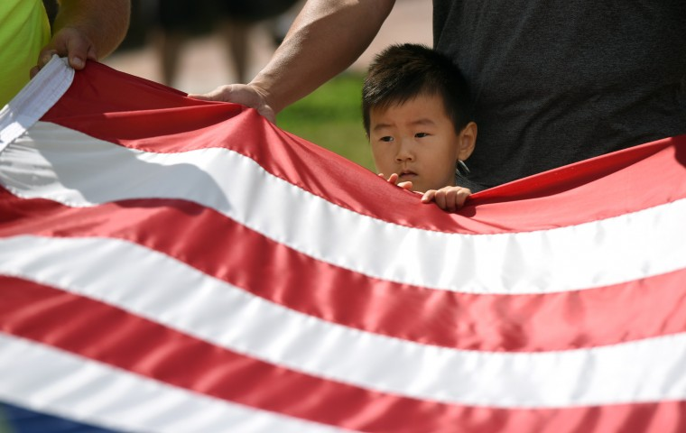 Daniel Kang, 3 1/2, and his father, Frank Kang, of Rockville, take part in the morning flag change at Fort McHenry National Monument and Historic Shrine. On this day it is a 1861 Civil War era flag they will raise. (Kim Hairston/Baltimore Sun)