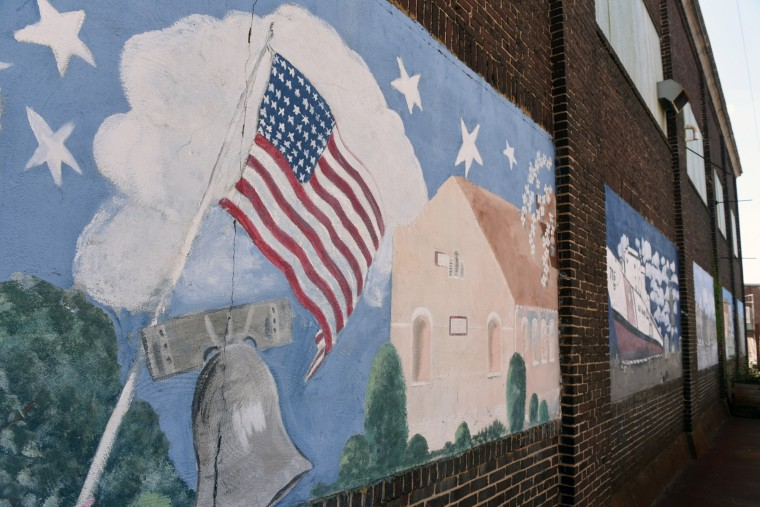 The American flag and Liberty Bell are among the national and local images painted on the side of a warehouse in Curtis Bay.  (Kim Hairston/Baltimore Sun)