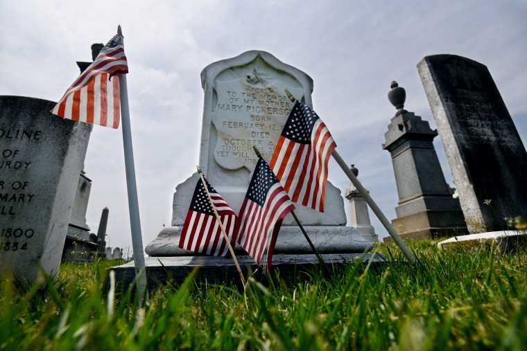 The gravesite of Mary Pickersgill is decorated with American flags. Pickersgill designed the 30 by 42 foot garrison flag that flew over Fort McHenry the morning after the Battle for Baltimore in 1814. It was that flag that inspired Francis Scott Key to write the poem that would become the National Anthem. (Kim Hairston/Baltimore Sun)