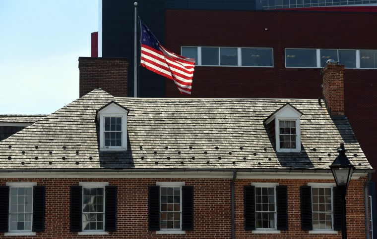 The  Star-Spangled Banner flies in the courtyard of the Star-Spangled Banner Flag House. The house is where Mary Pickersgill designed  the garrison flag for Fort McHenry. Pickersgill and a few women stitched the flag which would inspire the National Anthem.  (Kim Hairston/Baltimore Sun)