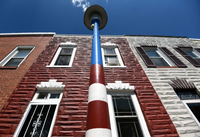 A light pole in the 1400 block of Cooksie Street is painted red, white and blue. Kim Hairston/Baltimore Sun)