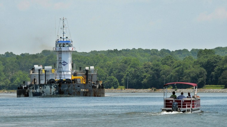 """Kirby,"" a tug and barge which transports fuel, travels on the C&D canal in Chesapeake City. The picture was taken from the Chesapeake City Ferry piloted by D. J. Fasick.(Algerina Perna/Baltimore Sun)"