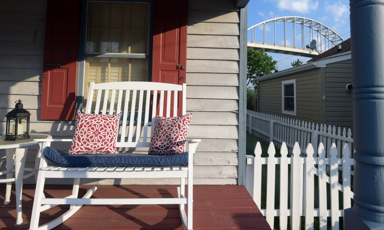 The Chesapeake City bridge is seen beyond the porch of the Metz house, built circa 1854. (Algerina Perna/Baltimore Sun)