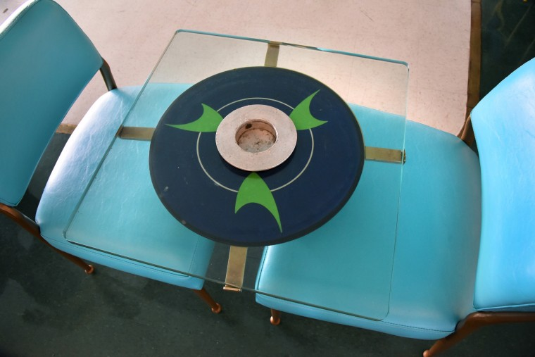 The futuristic cocktail tables originally had illuminated tops. At the center of each one, emblematic of that era, was an ashtray. (Amy Davis/Baltimore Sun)