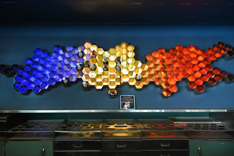 The focal point above the bar was a honeycombed, illuminated wine rack, inspired by the Trilinear Chart of the Nuclides. (Amy Davis/Baltimore Sun)
