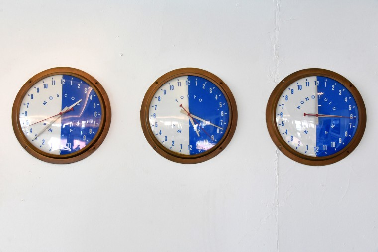 Six illuminated dial clocks were mounted next to the bar. These three showed the time in Moscow, Tokyo and Honolulu. The other three showed the ship's time, and the time in New York and London. (Amy Davis/Baltimore Sun)
