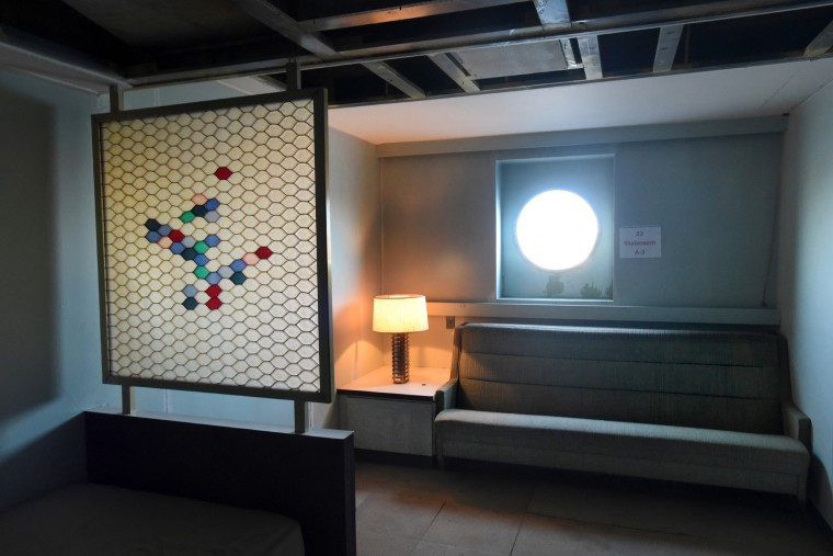 A refurbished stateroom with vintage modern built-ins reiterates the atomic age graphics on a screen decoration. (Amy Davis/Baltimore Sun)