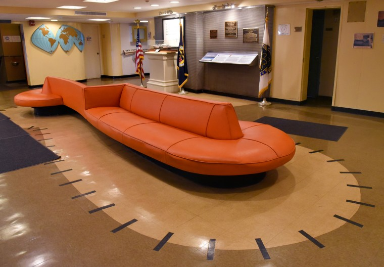 The outline of the restored serpentine settee is echoed in the modernistic linoleum floor design in the Purser's lobby of the N.S. Savannah.  (Amy Davis/Baltimore Sun)