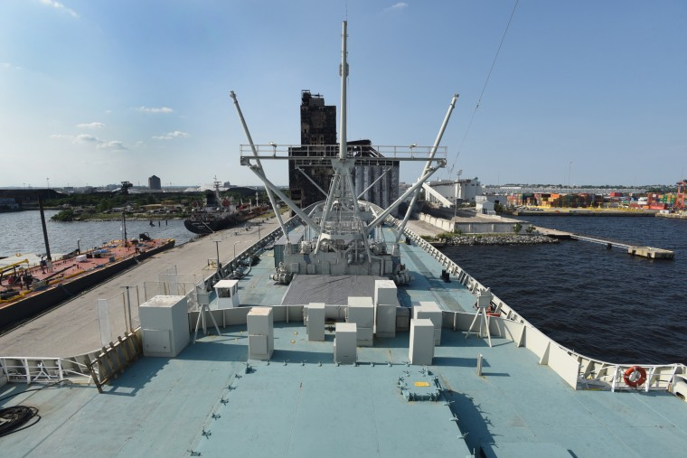 The cargo booms used to load break bulk cargo predate the container ship era. The  N.S. Savannah, the world's first nuclear-powered merchant ship, had smaller cargo holds than convention cargo ships.  (Amy Davis/Baltimore Sun)