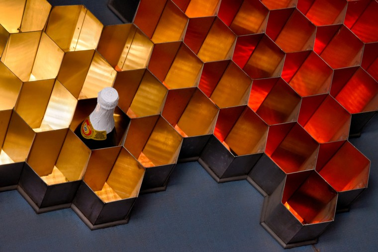 The wine rack above the bar, designed by Jack Heaney, was inspired by the Trilinear Chart of the Nuclides, which represented nuclear data as hexagons. T (Amy Davis/Baltimore Sun)