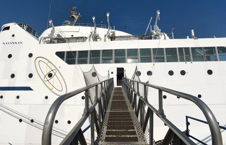 Visitors get a good view of the atom symbol on the N.S. Savannah as they ascend the gangway. The N.S. Savannah, the world's first nuclear-powered merchant ship, is docked at Pier 13 at the Canton Marine Terminal.  (Amy Davis/Baltimore Sun)