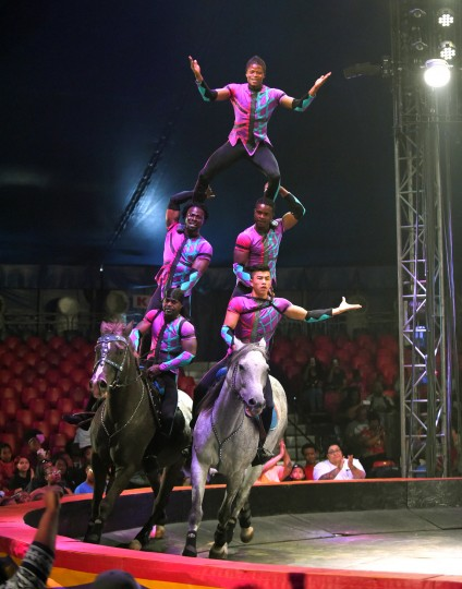 Horseback riding tricks are performed under the big top at the UniverSoul Circus. (Lloyd Fox/Baltimore Sun)