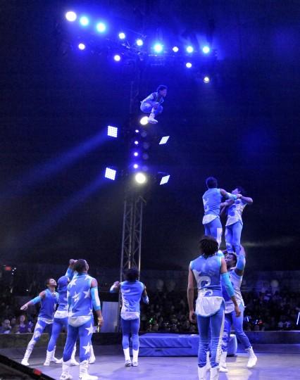 The Havana Company soar through the air during their acrobatic  routine. (Lloyd Fox/Baltimore Sun)