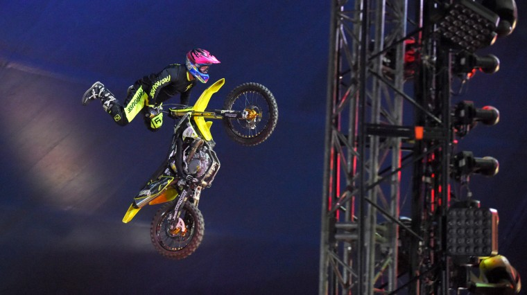 Motocross freestyle daredevils take to the air in the big top.  (Lloyd Fox/Baltimore Sun)