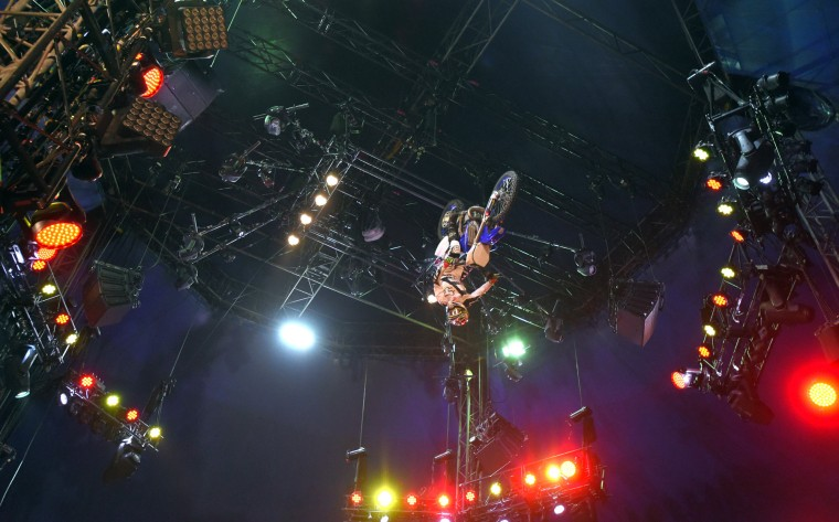 A member of the Xtreme Bikes team an act from Chicago and upstate New York, does a backflip on a motorcycle during the circus performance.  (Lloyd Fox/Baltimore Sun)