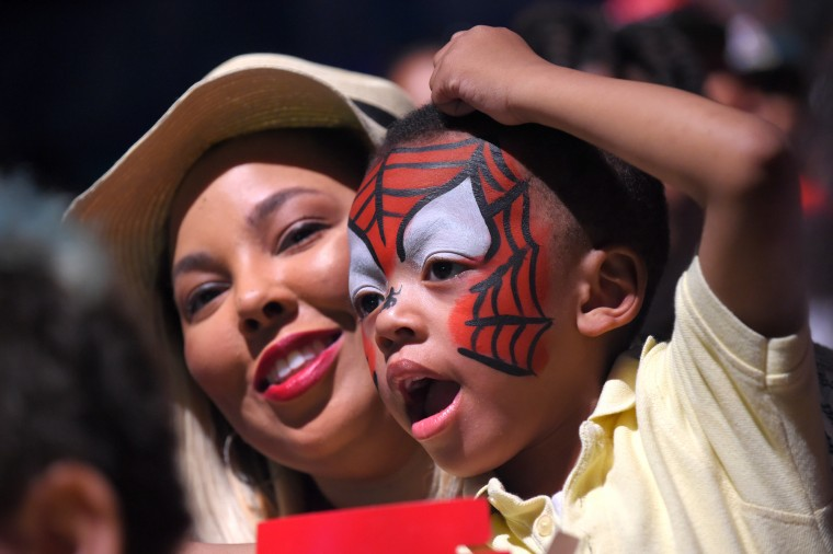 Krystal Morant of Baltimore with her son, William Morant III, 4, as they watch the UniverSoul Circus in Baltimore.  (Lloyd Fox/Baltimore Sun)