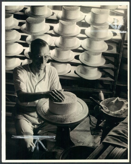 A man works at making a straw hat in a Baltimore factory in 1932. (Baltimore Sun archives)