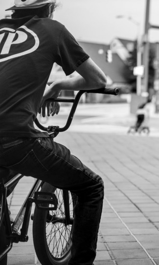 Baltimore, MD -- 5/27/17 -- A BMX rider waits for his turn to perform his trick on this location. Second Annual Baltimore BMX Street Jam. Over 150 BMX bike riders gathered on 300 North Greene street, Baltimore. Together they spent the whole day riding through the streets of Baltimore and exploring places that were once hidden to many riders. (Paul Lai)