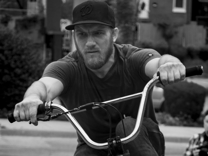 Baltimore, MD -- 5/27/17 -- David Zovko is in full focus mode while performing one of his tricks. Second Annual Baltimore BMX Street Jam. Over 150 BMX bike riders gathered on 300 North Greene street, Baltimore. Together they spent the whole day riding through the streets of Baltimore and exploring places that were once hidden to many riders. (Paul Lai)