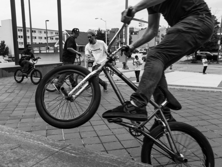 Baltimore, MD -- 5/27/17 -- BMX riders freestyle tricks at 300 North Greene street, Baltimore. Second Annual Baltimore BMX Street Jam. Over 150 BMX bike riders gathered on 300 North Greene street, Baltimore. Together they spent the whole day riding through the streets of Baltimore and exploring places that were once hidden to many riders. (Paul Lai)