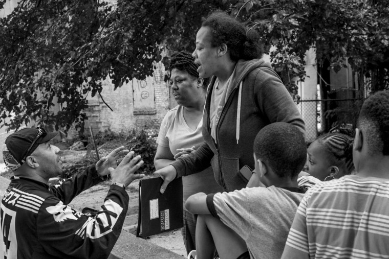 Baltimore, MD -- 5/27/17 -- Residents from the third location of the day came out to talk with some of the riders concerning the safety of young children who were watching the event. (Residents did not wish to be identified) Second Annual Baltimore BMX Street Jam. Over 150 BMX bike riders gathered on 300 North Greene street, Baltimore. Together they spent the whole day riding through the streets of Baltimore and exploring places that were once hidden to many riders. (Paul Lai)