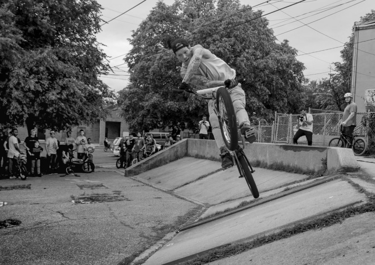 """Baltimore, MD -- 5/27/2017 -- Travis Pettit from Hagerstown, Maryland performs a """"X-up"""" in front of many riders. Second Annual Baltimore BMX Street Jam. Over 150 BMX bike riders gathered on 300 North Greene street, Baltimore. Together they spent the whole day riding through the streets of Baltimore and exploring places that were once hidden to many riders. (Paul Lai)"""